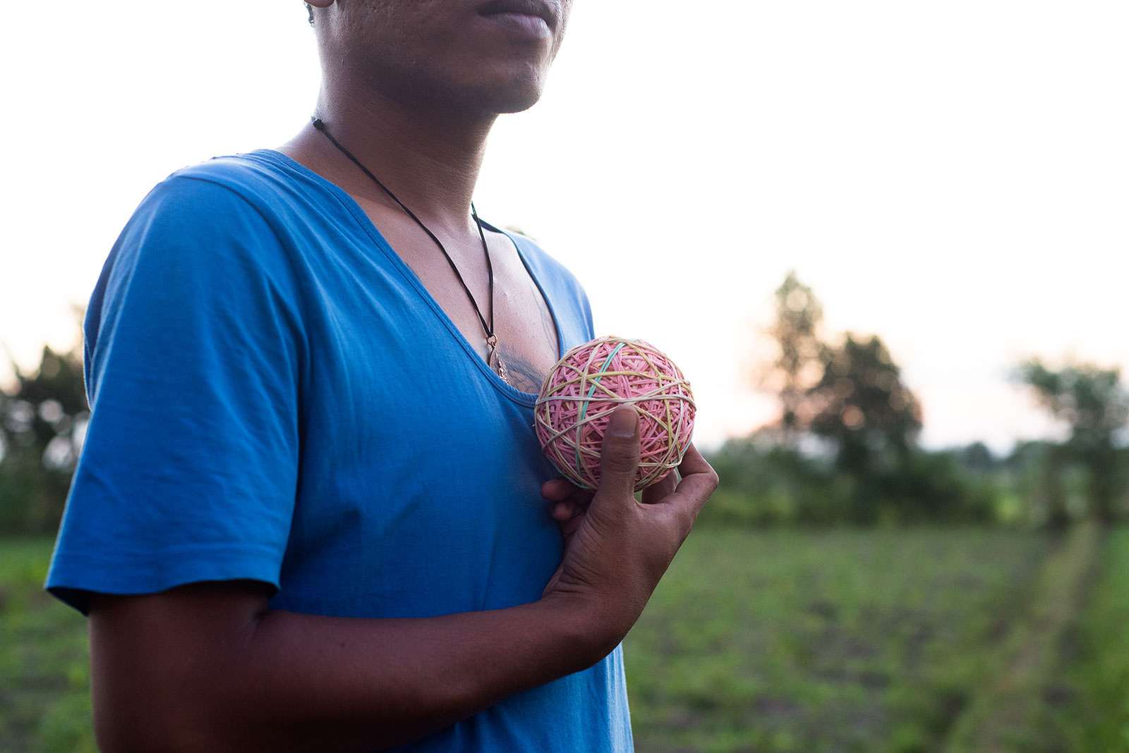 A man called Mawardi is shown holding a rubber bowl