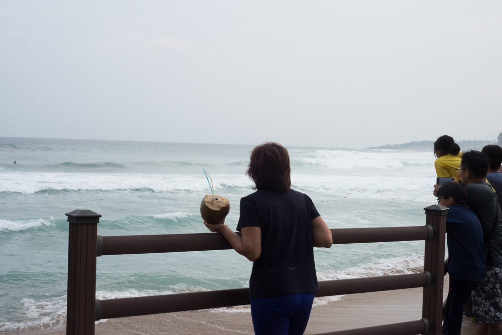 coconut drink and big waves