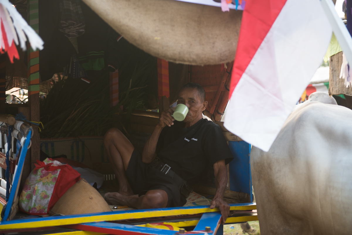 Man drinks coffee inside cowcart yogyakarta