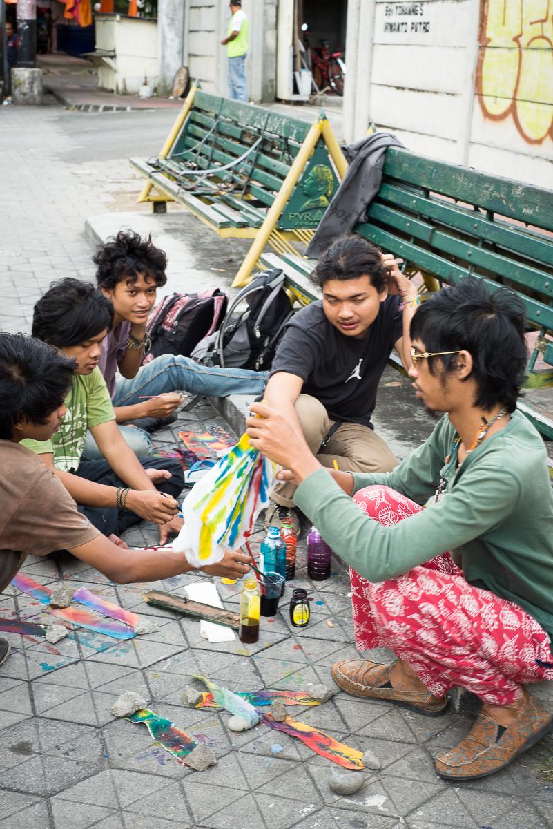 yogyakarta artists paint on sidewalk afternoon